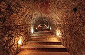 Dark staircase inside underground tunnel