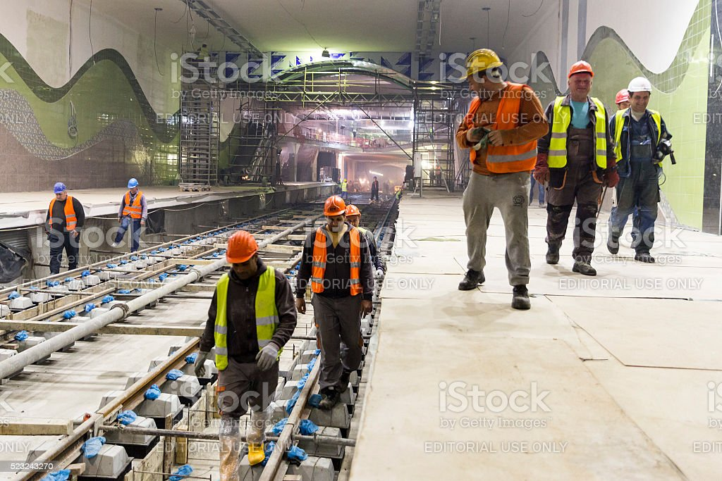 Underground subway tunnel workers stock photo