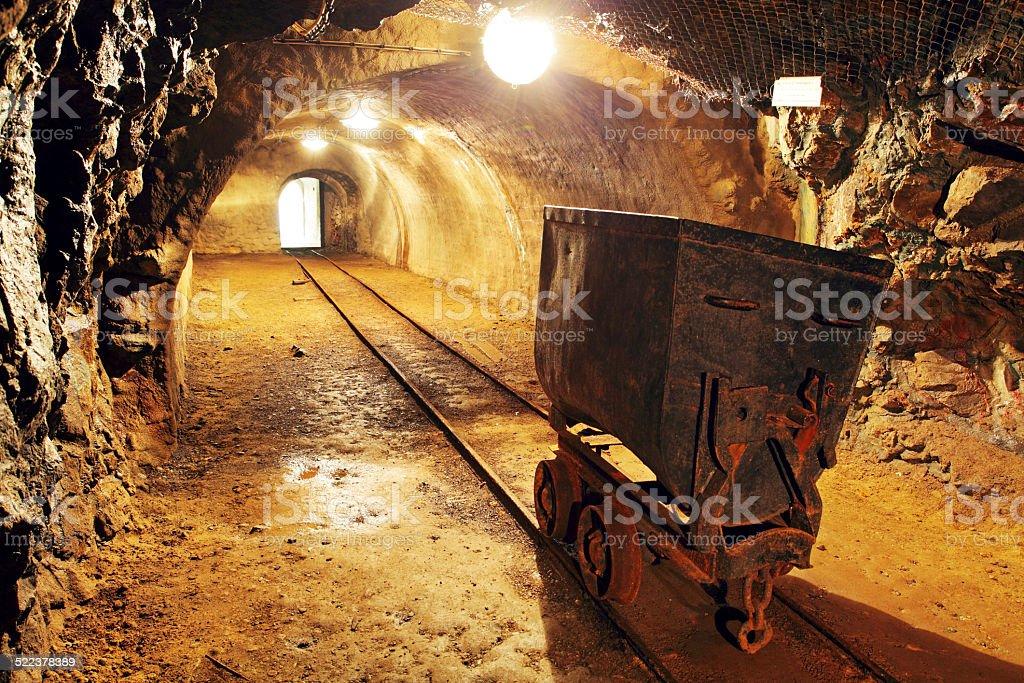 Underground train in mine, carts in gold, silver and copper mine. stock photo