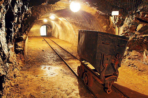 underground train in mine, carts in gold, silver and copper mine. - gold mine stock photos and pictures