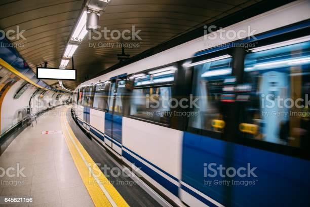 An underground train in motion in Madrid, Spain.