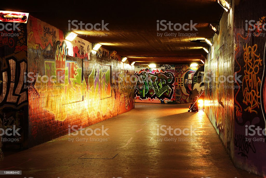 Underground Tunnel Covered With Graffiti And Dark Lights royalty-free stock photo