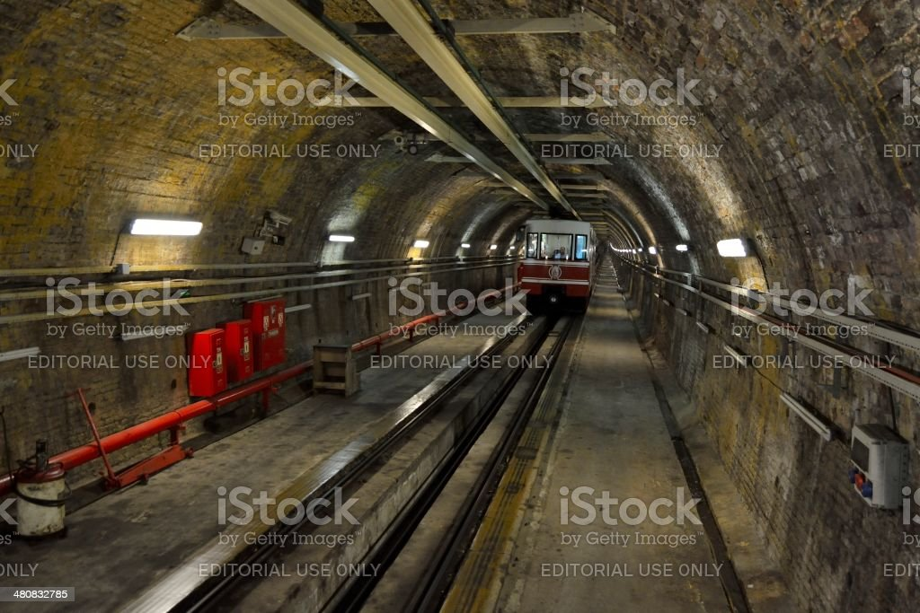 The driver of a cable car of the Tünel Funicular Line, seen from the...