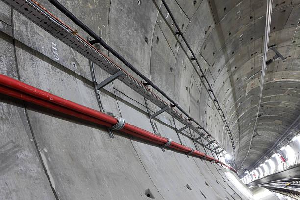Underground tunnel with lights stock photo