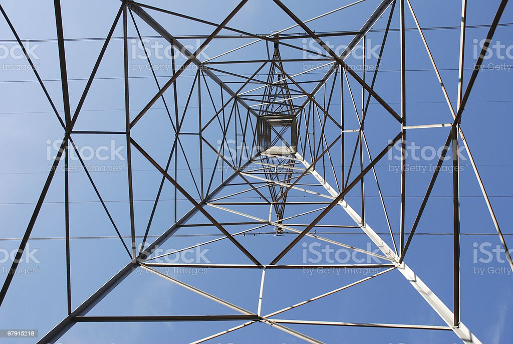 underneath an electric pylon royalty-free stock photo
