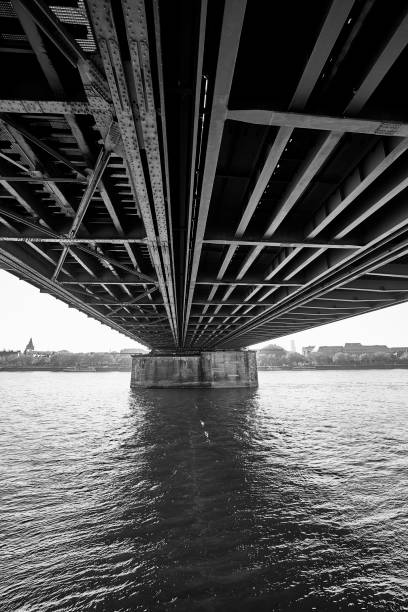 Underneath the marvelous Hohenzollern Bridge spanning the Rhine river in Cologne, Germany stock photo