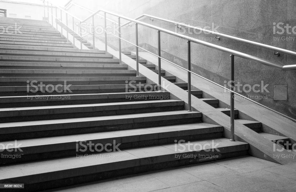 Underpass and concrete stairs in the city, black and white picture stock photo