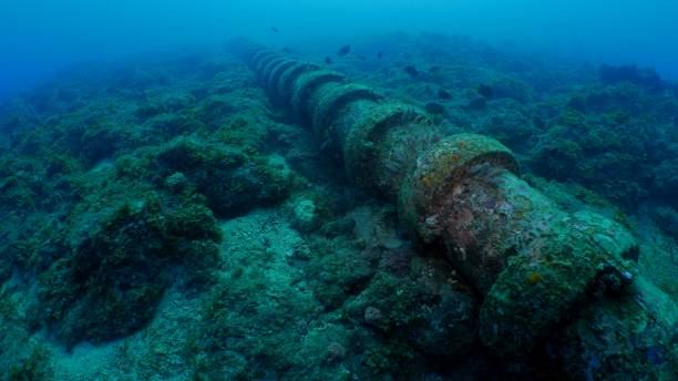 Undersea water pipe in coral reef stock photo