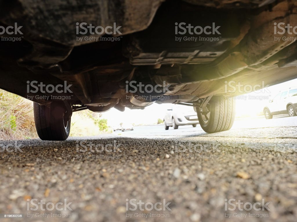 Underside of a car, worn and grubby stock photo