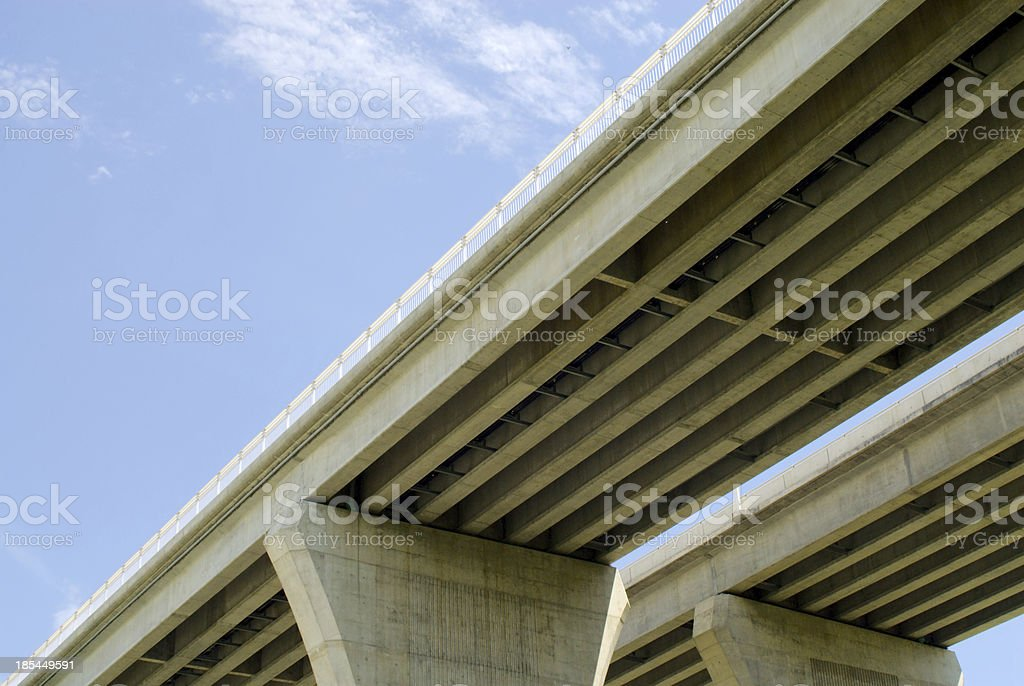 Underside of highway bridges on blue sky stock photo