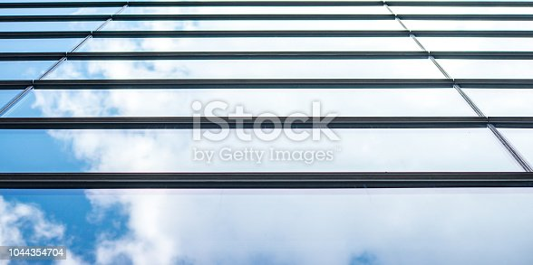 istock underside panoramic and perspective view to steel blue glass high rise building skyscrapers, business concept of successful industrial architecture 1044354704