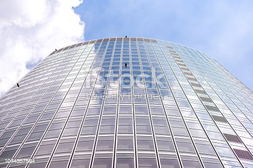 istock underside panoramic and perspective view to steel blue glass high rise building skyscrapers, business concept of successful industrial architecture 1044357564
