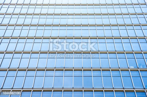 istock underside panoramic and perspective view to steel blue glass high rise building skyscrapers, business concept of successful industrial architecture 1044362100