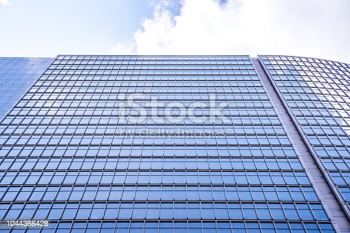 istock underside panoramic and perspective view to steel blue glass high rise building skyscrapers, business concept of successful industrial architecture 1044366428