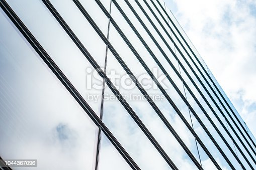 istock underside panoramic and perspective view to steel blue glass high rise building skyscrapers, business concept of successful industrial architecture 1044367096