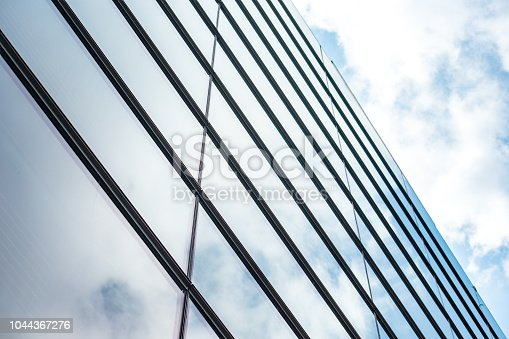istock underside panoramic and perspective view to steel blue glass high rise building skyscrapers, business concept of successful industrial architecture 1044367276