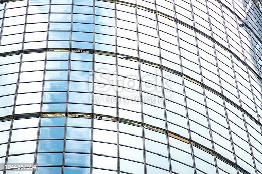 istock underside panoramic and perspective view to steel blue glass high rise building skyscrapers, business concept of successful industrial architecture 1044367954