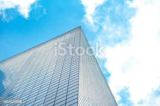 istock underside panoramic and perspective view to steel blue glass high rise building skyscrapers, business concept of successful industrial architecture 1044372556