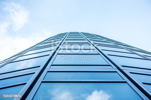 istock underside panoramic and perspective view to steel blue glass high rise building skyscrapers, business concept of successful industrial architecture 1044373874