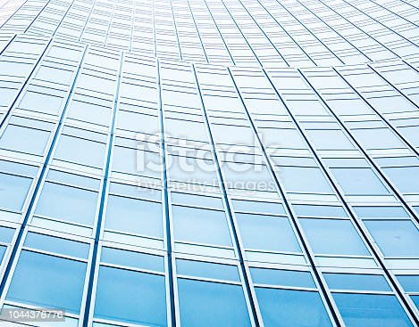 istock underside panoramic and perspective view to steel blue glass high rise building skyscrapers, business concept of successful industrial architecture 1044376776