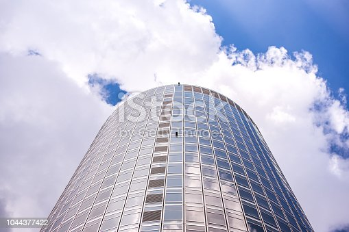 istock underside panoramic and perspective view to steel blue glass high rise building skyscrapers, business concept of successful industrial architecture 1044377422