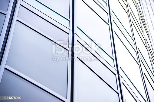 istock underside panoramic and perspective view to steel blue glass high rise building skyscrapers, business concept of successful industrial architecture 1044378040