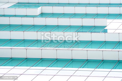 istock underside panoramic and perspective view to steel blue glass high rise building skyscrapers, business concept of successful industrial architecture 1059258176