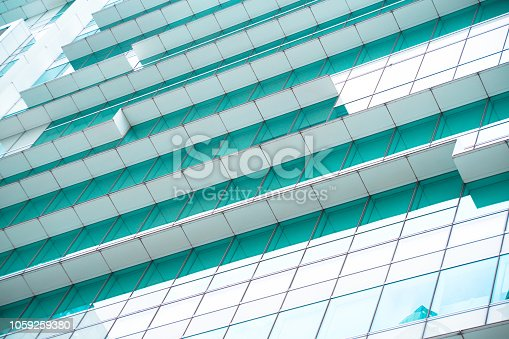 istock underside panoramic and perspective view to steel blue glass high rise building skyscrapers, business concept of successful industrial architecture 1059259380