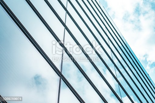 istock underside panoramic and perspective view to steel blue glass high rise building skyscrapers, business concept of successful industrial architecture 1059259974