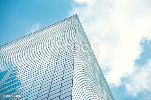 istock underside panoramic and perspective view to steel blue glass high rise building skyscrapers, business concept of successful industrial architecture 1059260486