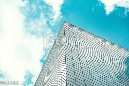 istock underside panoramic and perspective view to steel blue glass high rise building skyscrapers, business concept of successful industrial architecture 1059262296