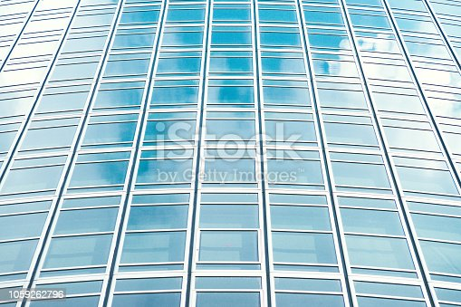 istock underside panoramic and perspective view to steel blue glass high rise building skyscrapers, business concept of successful industrial architecture 1059262796