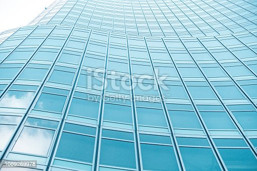 istock underside panoramic and perspective view to steel blue glass high rise building skyscrapers, business concept of successful industrial architecture 1059269978