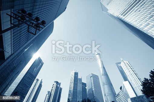 868153090 istock photo underside panoramic and perspective view to steel glass high rise building skyscrapers, business concept of successful industrial architecture 835384382