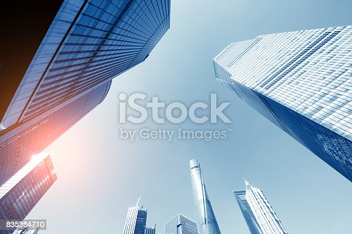 868153090 istock photo underside panoramic and perspective view to steel glass high rise building skyscrapers, business concept of successful industrial architecture 835384710