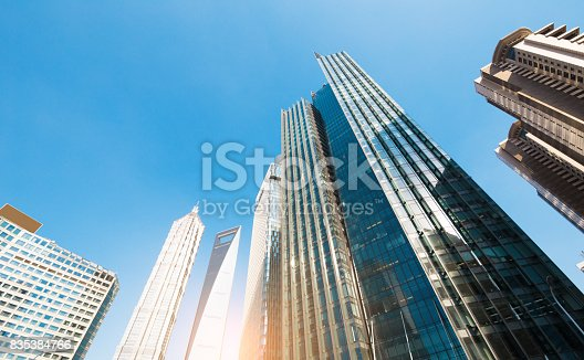 868153090 istock photo underside panoramic and perspective view to steel glass high rise building skyscrapers, business concept of successful industrial architecture 835384766