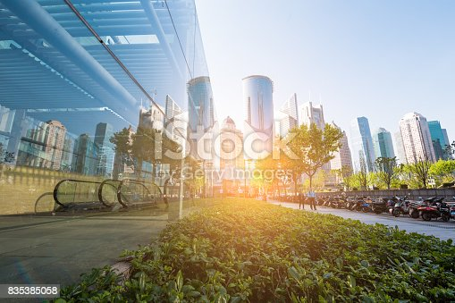 istock underside panoramic and perspective view to steel glass high rise building skyscrapers, business concept of successful industrial architecture 835385058