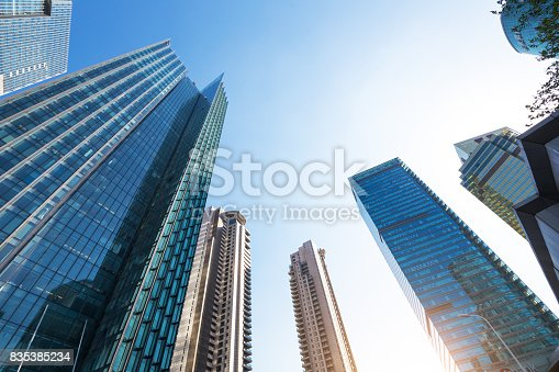868153090 istock photo underside panoramic and perspective view to steel glass high rise building skyscrapers, business concept of successful industrial architecture 835385234