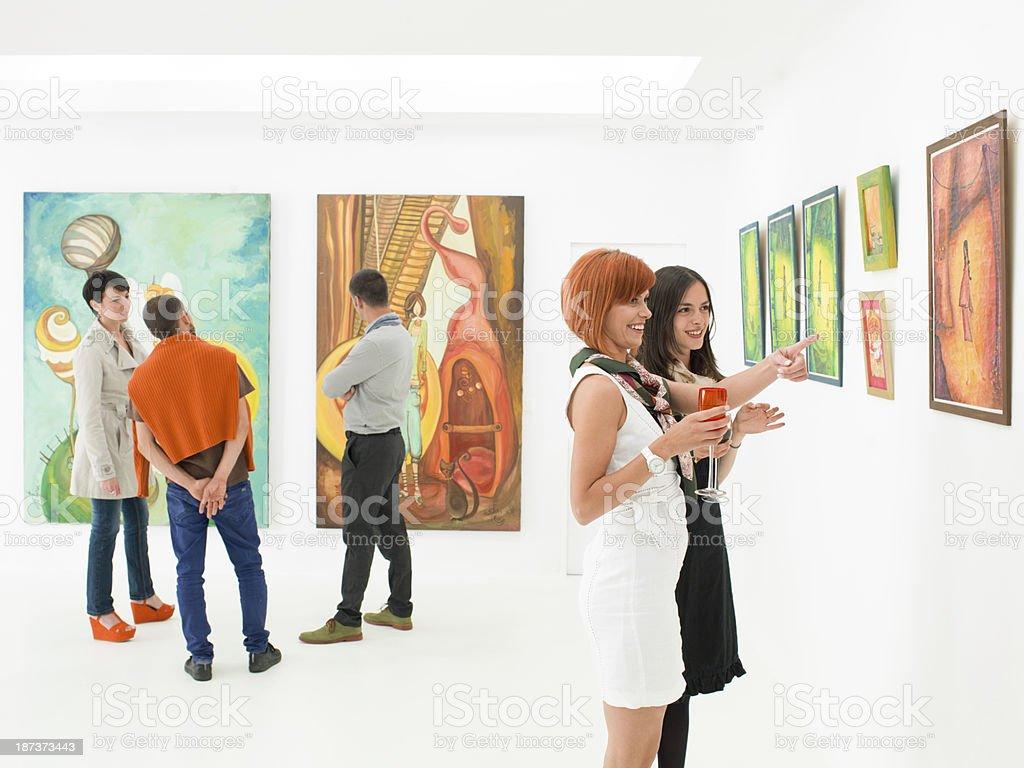 understanding art at exhibition opening stock photo