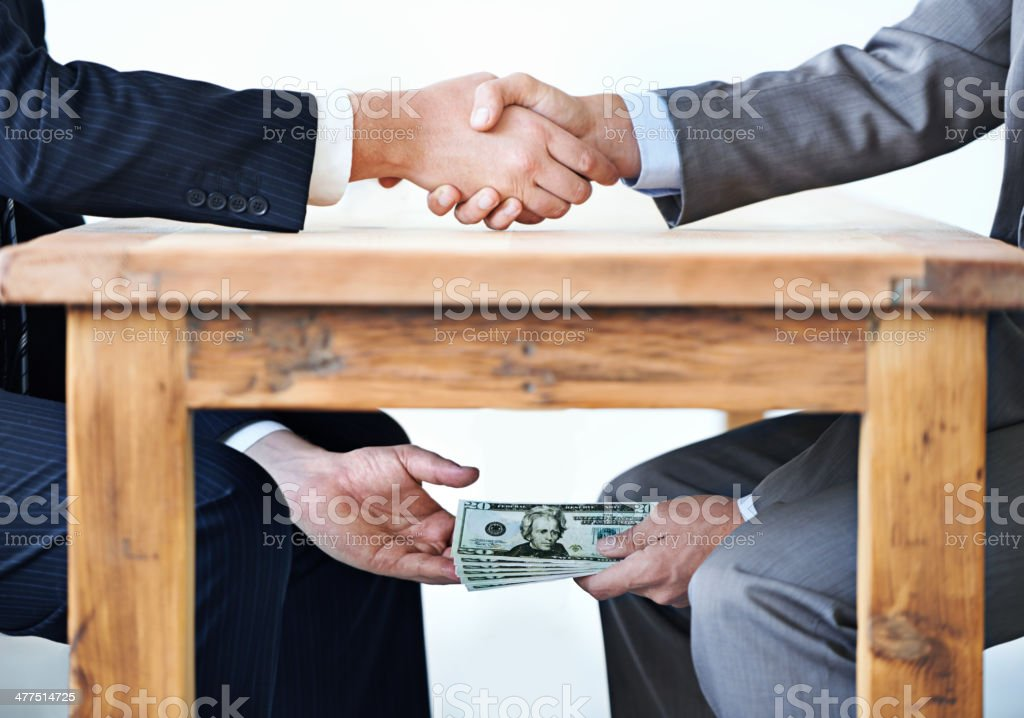 Under-the-table transactions... stock photo