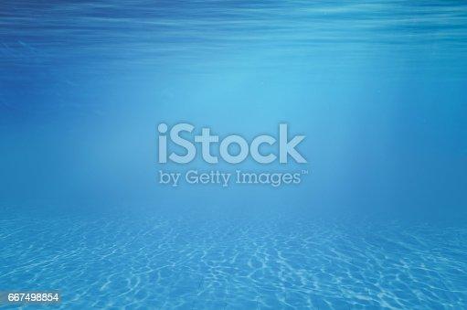 istock Underwater blue background 667498854