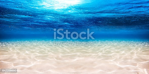 istock underwater blue ocean sandy background 642258650