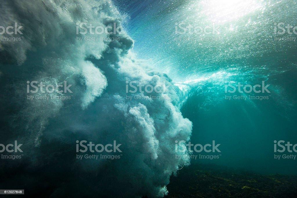 Underwater breaking wave stock photo