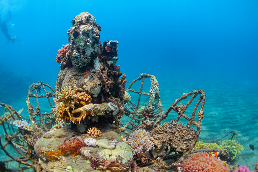 Underwater Buddha Statue With Diving Snorkeler On The Background0122 Stock Photo - Download Image Now