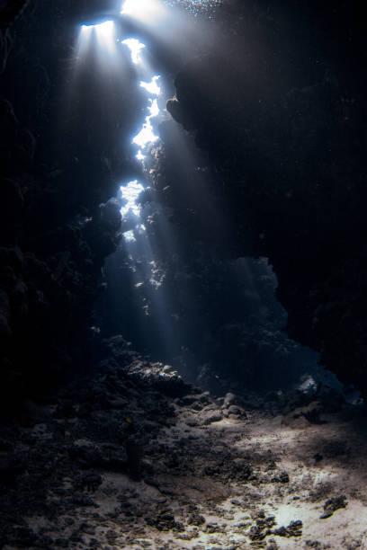 underwater cave - immerse in the stars foto e immagini stock