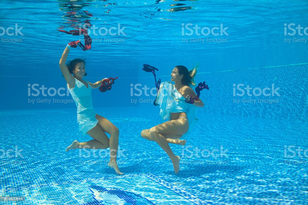 Underwater Fashion Pool Party Two Woman Dancing In Swimming Pool ...