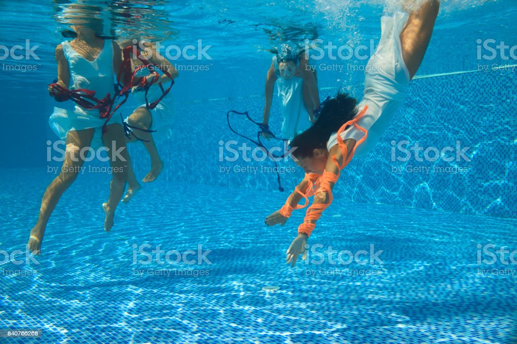 Underwater view of girl in a swimming pool stock photo