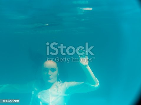 snorkeling girl lies on the surface of water. underwater inverted form.