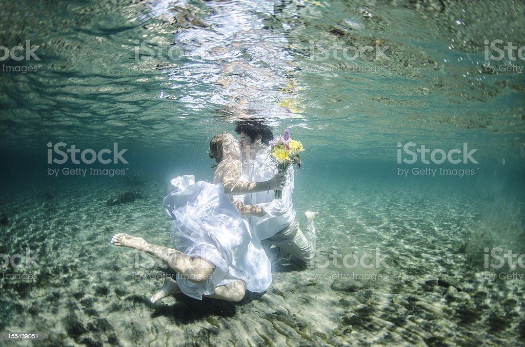 underwater kiss stock photo