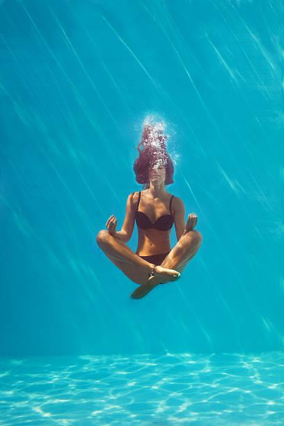 underwater meditation stock photo